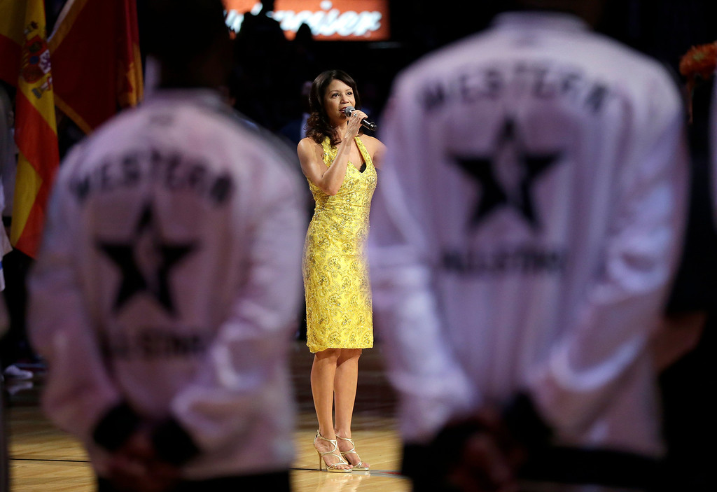 . Gloria Reuben performs the Canadian national anthem before the NBA All-Star basketball game Sunday, Feb. 17, 2013, in Houston. (AP Photo/Eric Gay)
