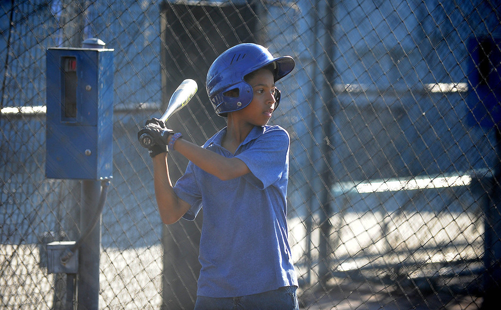 . 05-10-2013-(LANG Staff Photo by Sean Hiller)-  Lakewood Batting Cages located on Paramount and Cover Street is going out of business after 27 years  after their lease was not renewed. Miles Perry,11, of the Lakewood Village Little League Major Pirates practices for a playoff game.