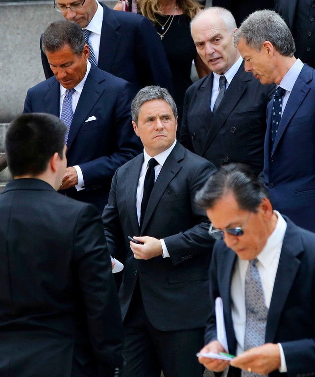 . HBO CEO Richard Plepler, left, Paramount CEO Brad Grey, center, and Soprano\'s creator David Chase, top second from right, leave the Cathedral Church of Saint John the Divine after the funeral service for James Gandolfini, Thursday, June 27, 2013 in New York.  (AP Photo/Mary Altaffer)