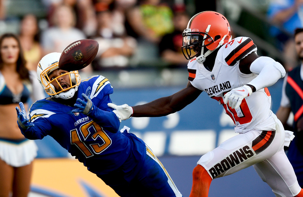. Cleveland Browns cornerback Jason McCourty, right, breaks up a pass intended for Los Angeles Chargers wide receiver Keenan Allen during the second half of an NFL football game Sunday, Dec. 3, 2017, in Carson, Calif. (AP Photo/Kelvin Kuo)