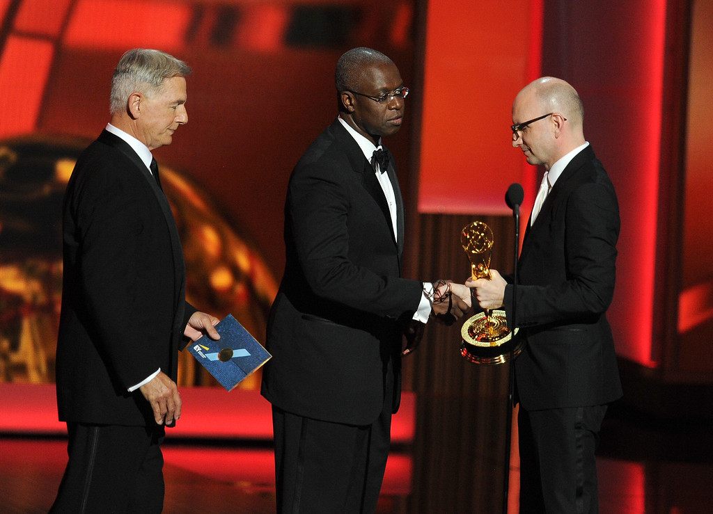 . Actors Mark Harmon (L) and Andre Braugher present an award to Steven Soderbergh onstage during the 65th Annual Primetime Emmy Awards held at Nokia Theatre L.A. Live on September 22, 2013 in Los Angeles, California.  (Photo by Kevin Winter/Getty Images)