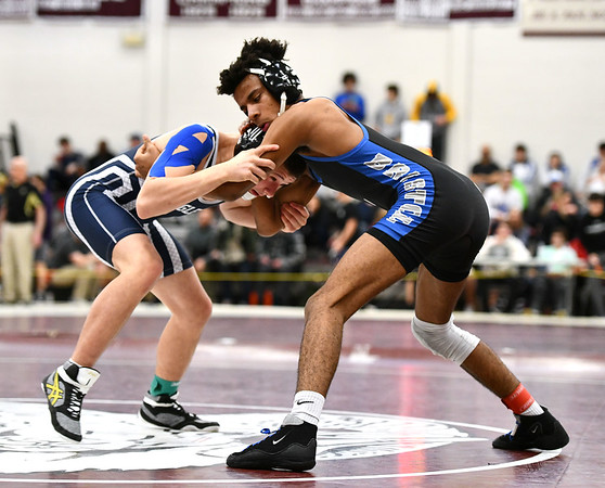 2/22/2020 Mike Orazzi | StaffrBristol Eastern's Cameron Cruz and Wethersfield's Thomas Krystopa in a 132 pound match during the Class L State Wrestling Tournament held at Bristol Central High School on Saturday.