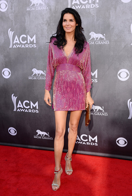 . Angie Harmon arrives at the 49th annual Academy of Country Music Awards at the MGM Grand Garden Arena on Sunday, April 6, 2014, in Las Vegas. (Photo by Al Powers/Powers Imagery/Invision/AP)
