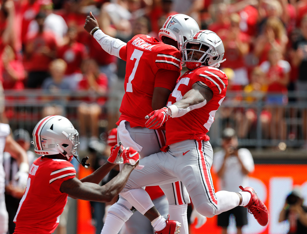 . Ohio State running back Mike Weber, right, and quarterback Dwayne Haskins celebrate Weber\'s touchdown against Oregon State during the first half of an NCAA college football game Saturday, Sept. 1, 2018, in Columbus, Ohio. (AP Photo/Jay LaPrete)