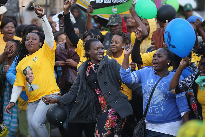 . Well-wishers sing and dance to celebrate the 95th birthday of their \'Father of the Nation\' Nelson Mandela outside the Mediclinic Heart Hospital where he is being treated on July 18, 2013 in Pretoria, South Africa. The South African presidency has said that Mandela\'s health is \'steadily improving\', as the anti-apartheid icon spends his 95th birthday in hospital. Children in schools across the country have started off Mandela Day by singing \'Happy Birthday\' to him.  (Photo by Christopher Furlong/Getty Images)