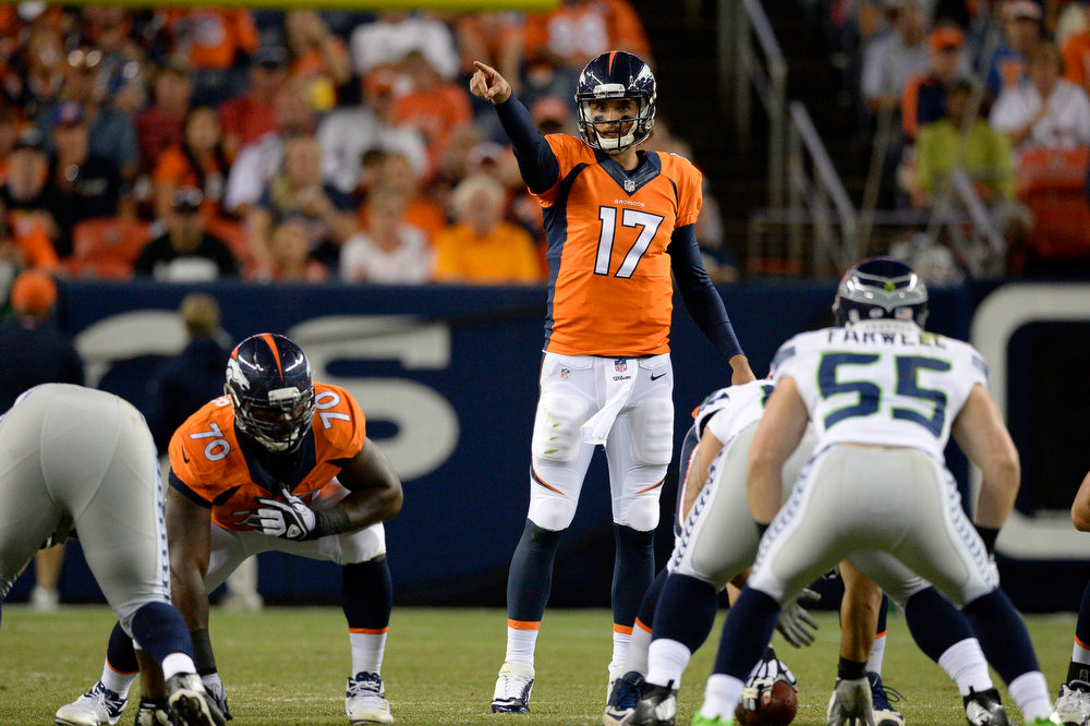 . Denver Broncos quarterback Brock Osweiler (17) points out the the Seattle Seahawks defense during the third quarter August 7, 2014 at Sports Authority Field at Mile High Stadium.  (Photo by John Leyba/The Denver Post)