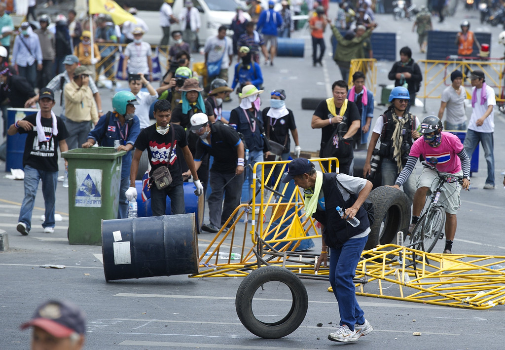 . Thai anti government protesters move rubber wheel to make bunkers after clashing with riot policemen following their demands for protesters to leave the area around the Government House in Bangkok on February 18, 2014.  AFP PHOTO/PORNCHAI  KITTIWONGSAKUL/AFP/Getty Images