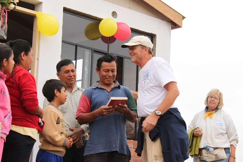 Millard Fuller Legacy Build in Peru, 2012: At the end of the build, homeowner partners are presented with a Bible signed by the volunteers who worked alongside them all week.