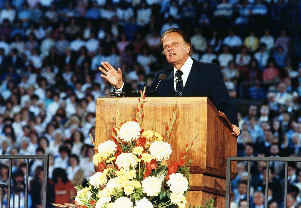 . Rev. Billy Graham is shown preaching to 24,000 people in Tacoma\'s New Dome Stadium, May 16, 1983, Tacoma, Wash. (AP Photo/Dave Ekren)