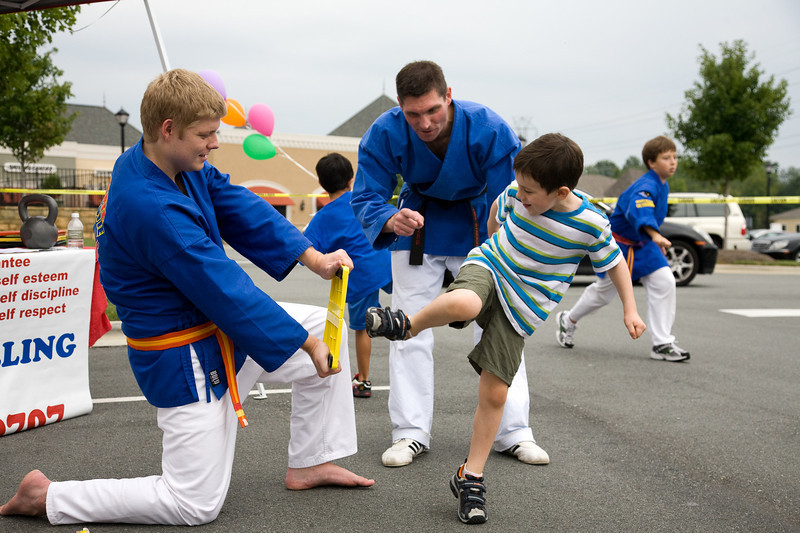(Left to right)  Graham Cousar, Mike Streicher of Karate Charlotte, Chase Travland.