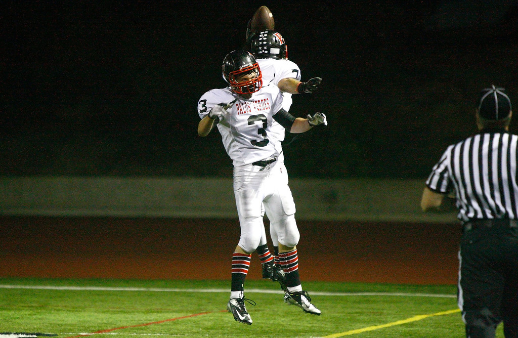 . Wide receiver Lance Brown #7 and Tyler Moore #3 of Palos Verdes celebrate after Brown\'s touchdown catch against the defense of Mira Costa in a Bay League matchup at Mira Costa High School on Friday, October 18, 2013 in Manhattan Beach, Calif.  (Michael Yanow / For the Daily Breeze)