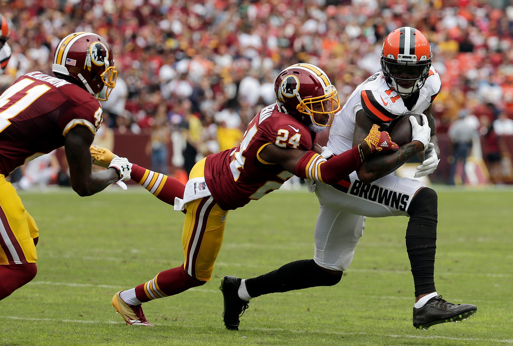 . Cleveland Browns wide receiver Terrelle Pryor (11) is tackled by Washington Redskins cornerback Josh Norman (24) during the first half of an NFL football game Sunday, Oct. 2, 2016, in Landover, Md. (AP Photo/Chuck Burton)