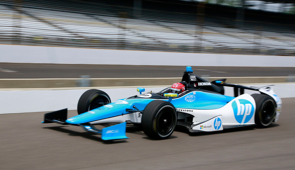 . Schmidt-Hamilton Motorsports driver Simon Pagenaud of France races down the pit lane during a practice session at the Indianapolis Motor Speedway in Indianapolis, Indiana May 16, 2013. The 97th running of the Indianapolis 500 is scheduled for May 26.  REUTERS/Brent Smith