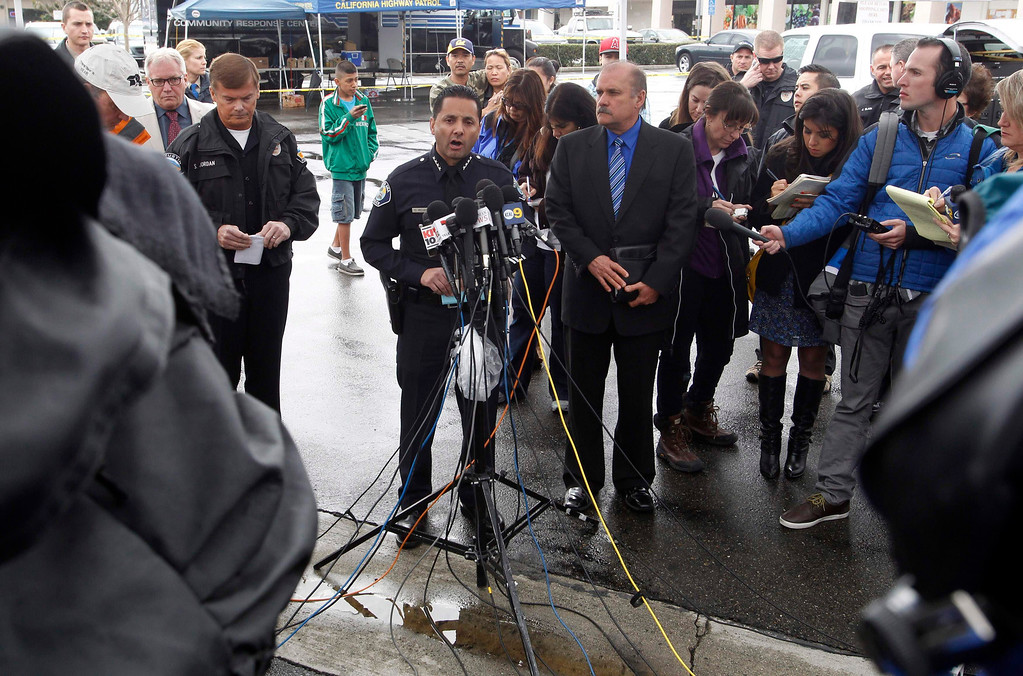 . Orange County sheriff\'s spokesman Jim Amormino (R) with Santa Ana Police Chief Carlos Rojas (C) talk about the Tuesday shooting events during a news conference in Tustin, California February 19, 2013.REUTERS/Alex Gallardo