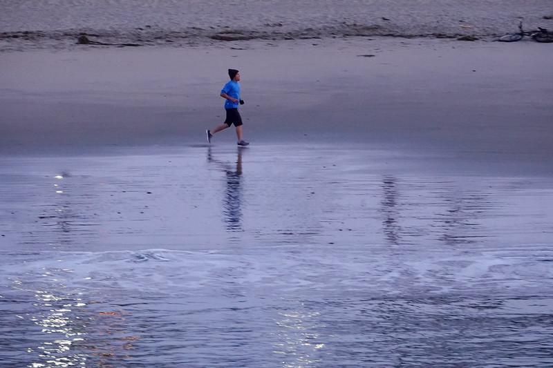 Running across the sands on Main Beach in Santa Cruz