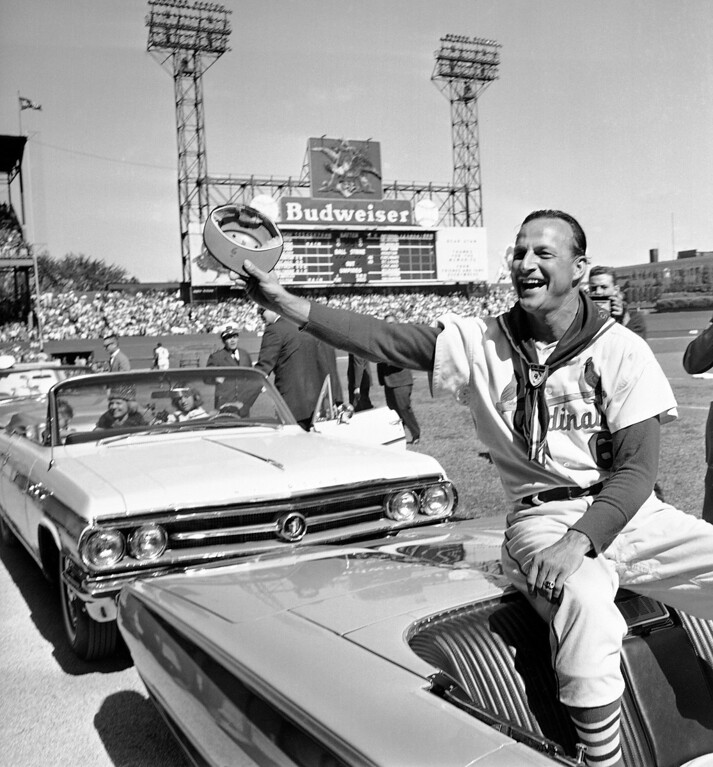 . FILE - In this Sept. 29, 1963 file photo, St. Louis Cardinals\' Stan Musial waves to fans during ceremonies marking the his last game as a player before a baseball game against the Cincinnati Reds in St. Louis. Musial, one of baseball\'s greatest hitters and a Hall of Famer with the Cardinals for more than two decades, died Saturday, Jan. 19, 2013, the team announced. He was 92. (AP Photo/File)