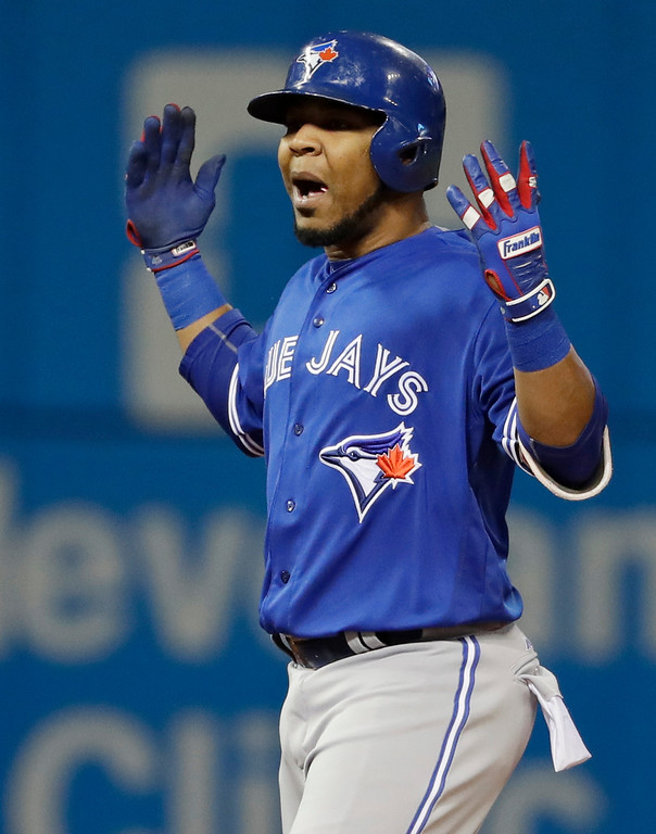 . Toronto Blue Jays\' Edwin Encarnacion celebrates after a double against the Cleveland Indians during the first inning in Game 1 of baseball\'s American League Championship Series in Cleveland, Friday, Oct. 14, 2016. (AP Photo/Matt Slocum)