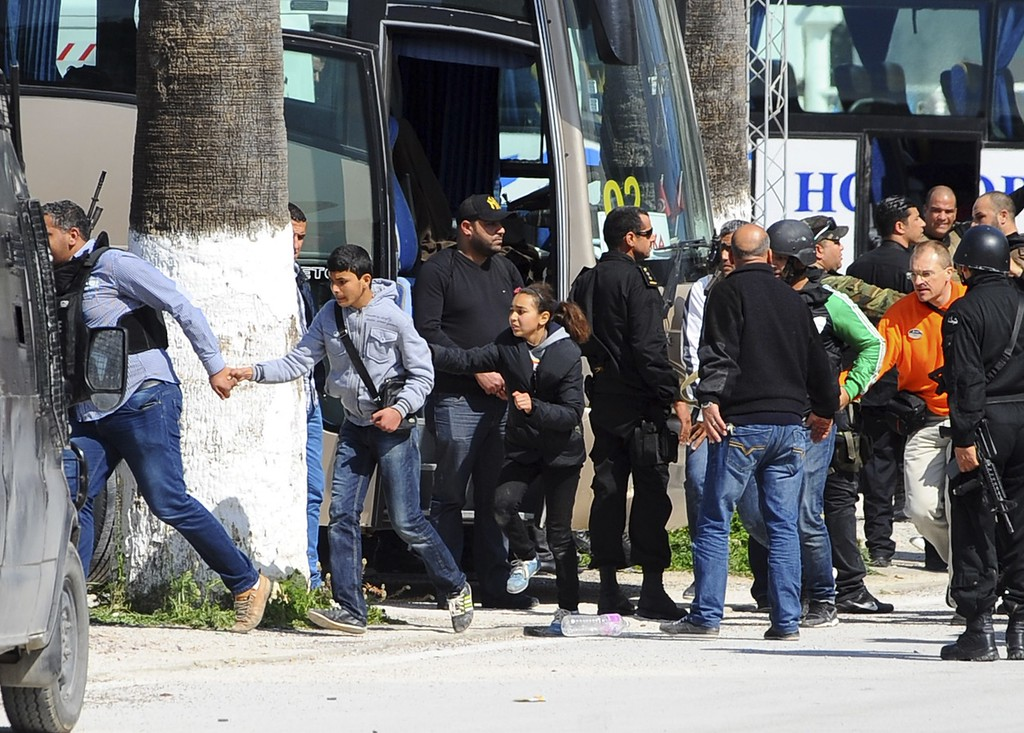 . Tourists and visitors from the Bardo museum are evacuated in Tunis, Wednesday, March 18, 2015 in Tunis, Tunisia. Gunmen opened fire at a leading museum in Tunisia\'s capital, killing 19 people  including 17 tourists, the Tunisian Prime Minister said. A later raid by security forces left two gunmen and one security officer dead but ended the standoff, Tunisian authorities said. (AP Photo/Hassene Dridi)