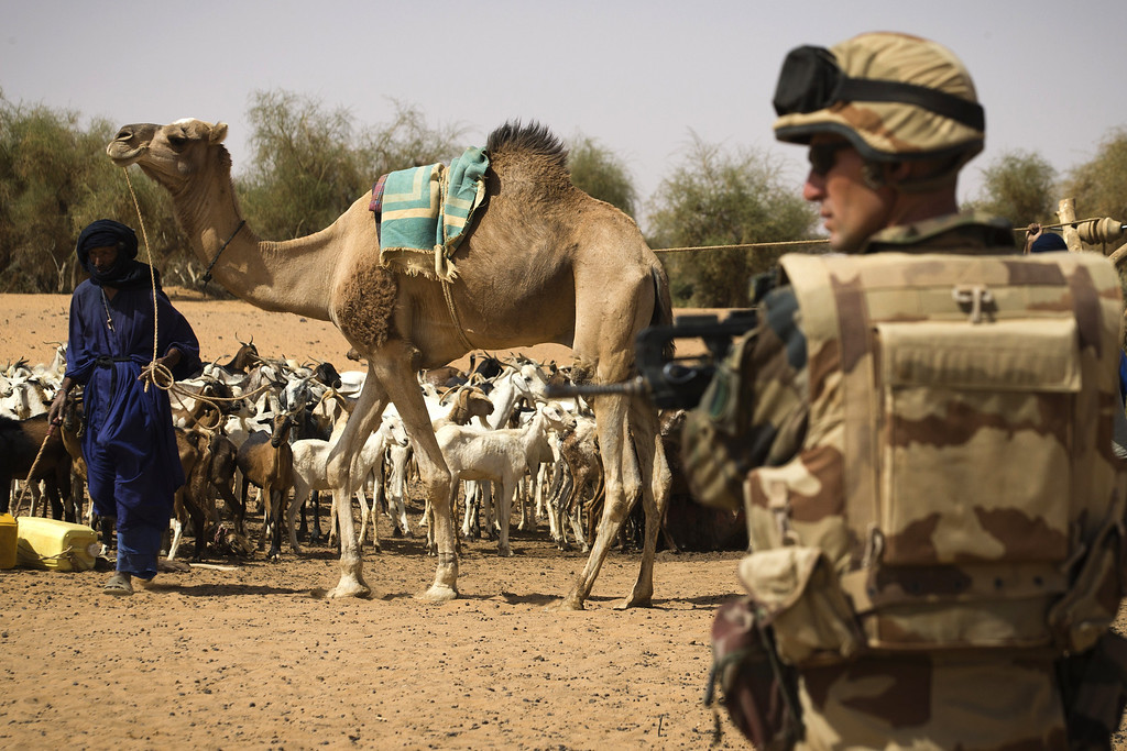 . French soldier from the 126 RI stands guard near a well during the Operation Gustav, a hunt for Islamist fighters in a valley in northern Mali and one of France\'s largest military operations during its three-month intervention in its former colony, on April 9, 2013, 105 km North of Gao. Operation Gustav comes with France preparing to withdraw three-quarters of the 4,000 troops it deployed in January to block a feared advance on the Malian capital Bamako by Al Qaeda-linked insurgents. JOEL SAGET/AFP/Getty Images