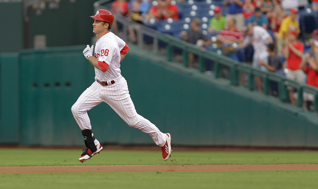 . Philadelphia Phillies\' Chase Utley runs the bases after hitting a home run in the first inning in a baseball game against the Colorado Rockies, Wednesday, Aug. 21, 2013, in Philadelphia. (AP Photo/Laurence Kesterson)