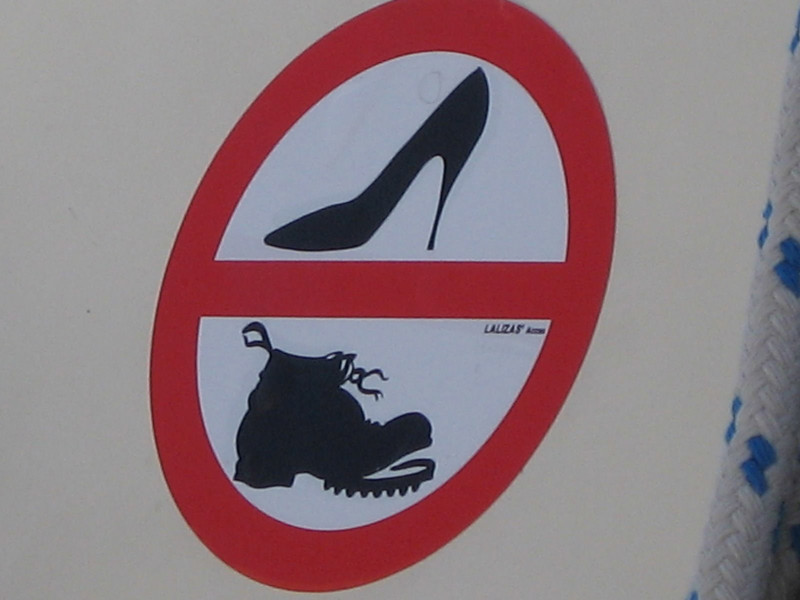 The sign on the boat telling us that no shoes were allowed.