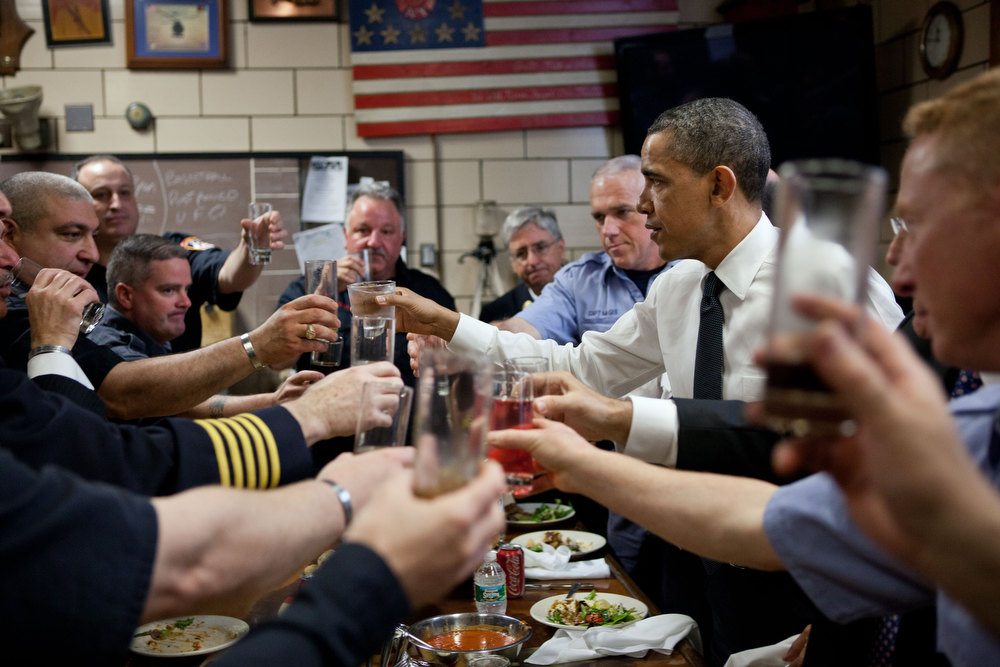 ". May 5, 2011 ""A few days after the mission against bin Laden, the President traveled to New York City to meet with families of the 9/11 victims. He also visited at Engine 54, Ladder 4, Battalion 9 Firehouse. The firehouse, known as the \""Pride of Midtown,\"" lost 15 firefighters on 9/11 -- an entire shift and more than any other New York firehouse. Here, the firefighters offer an impromptu toast to the President in honor of their fallen comrades during a lunch at the station house.\"" (Official White House Photo by Pete Souza)"