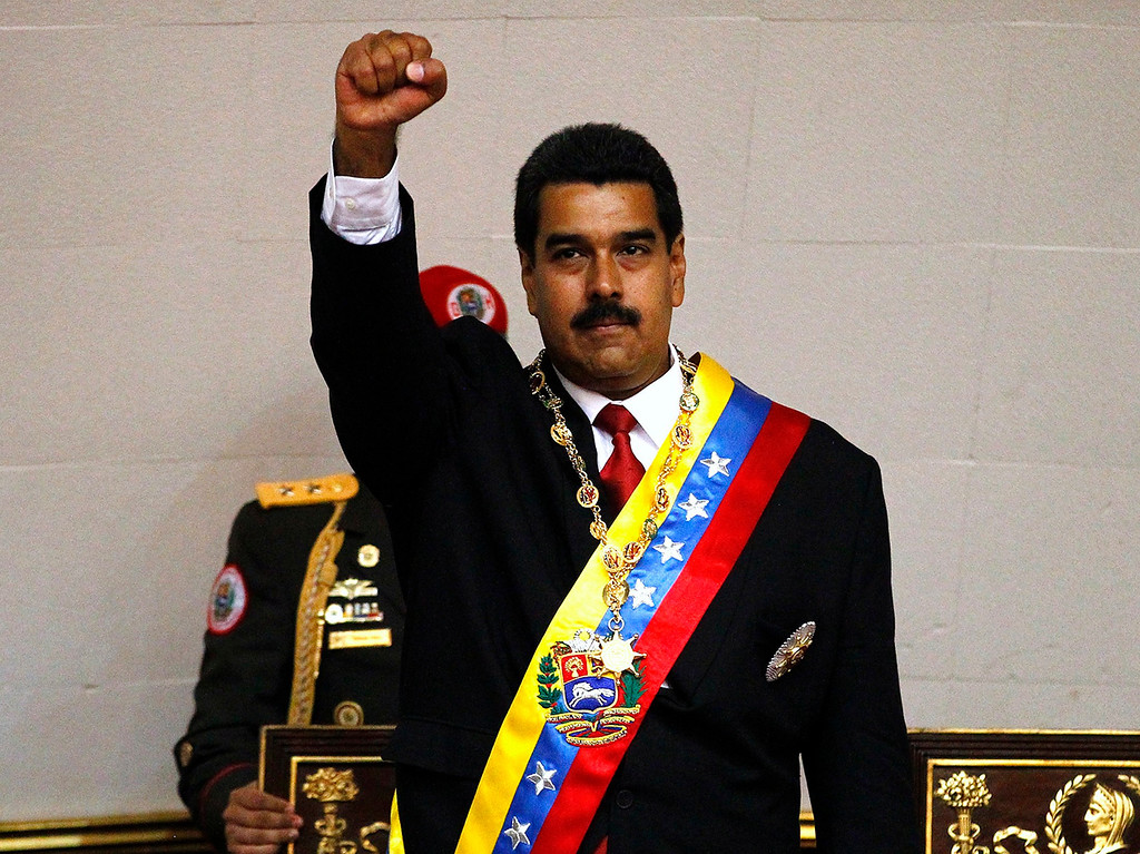 . Venezuela\'s President Nicolas Maduro gestures after being sworn into office in Caracas April 19, 2013. Maduro was sworn in as Venezuela\'s president on Friday at a ceremony attended by several Latin American leaders, after a decision to widen an electronic audit of the vote took some of the heat out of a dispute over his election.     REUTERS/Carlos Garcia Rawlins