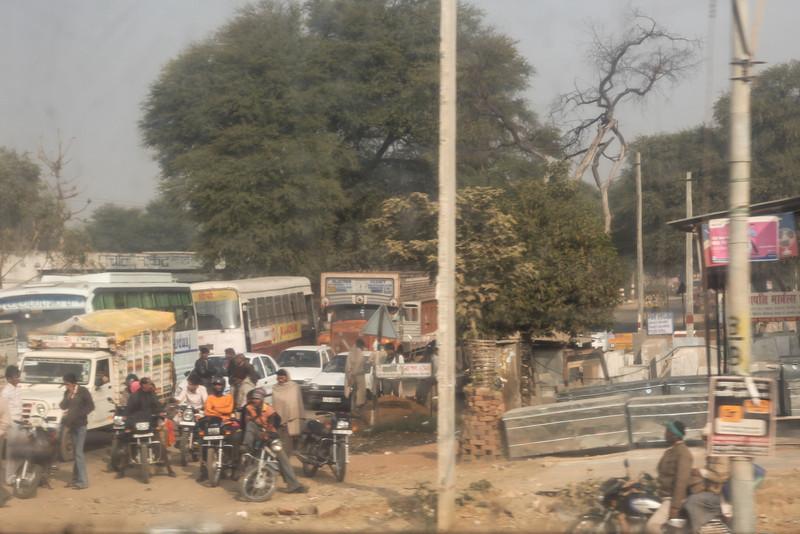 Traffic waiting to cross the train tracks.