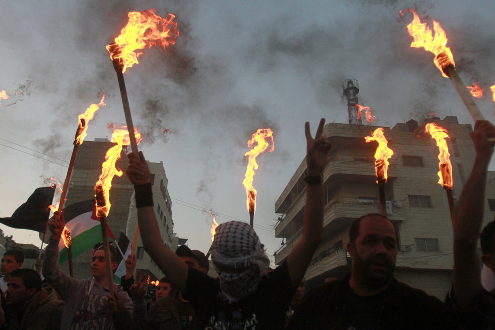 ". Palestinian protestors hold up torches during a rally to commemorate the 1948 creation of Israel known in Arabic as the ""Nakba\"" (catastrophe) in the West Bank city of Bethlehem on May 14, 2013. Palestinians are preparing to mark Nakba day on May 15 which commemorates the exodus of hundreds of thousands of their kin after the establishment of Israel state.  MUSA AL-SHAER/AFP/Getty Images"