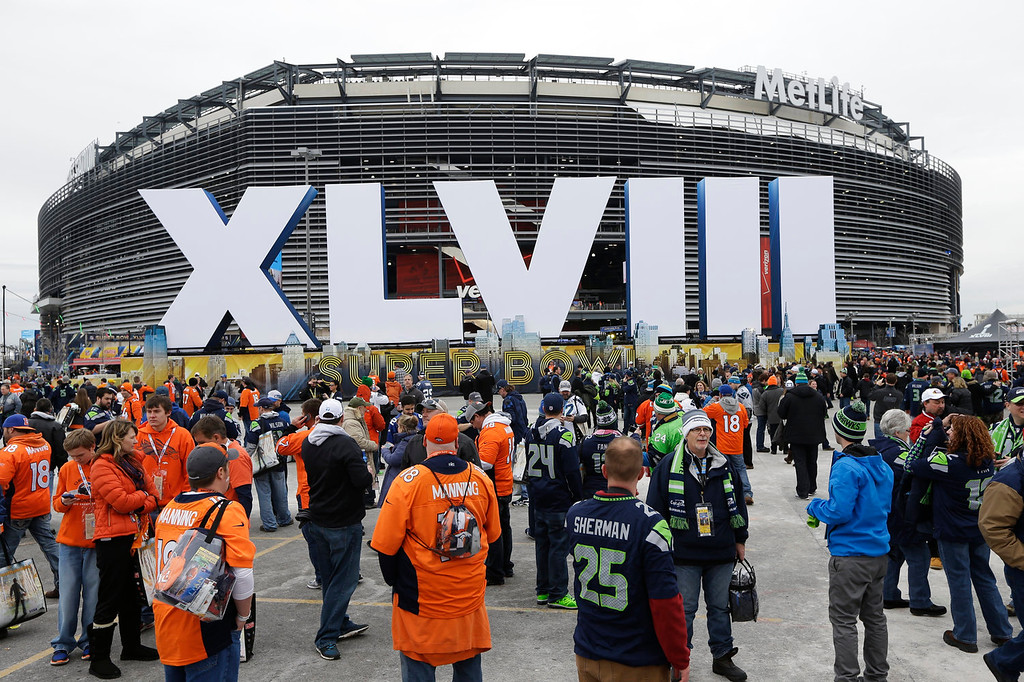 . Fans arrive for the NFL Super Bowl XLVIII football game between the Seattle Seahawks and the Denver Broncos at MetLife Stadium Sunday, Feb. 2, 2014, in East Rutherford, N.J. (AP Photo/Seth Wenig)