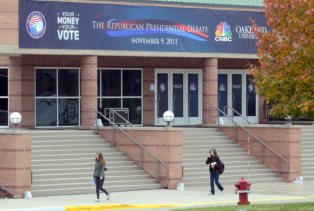 . Students walk past the front entrance of the O\'Rena  at Oakland University as it is being prepared for Wednesday\'s GOP Presidential Debate, pictured Monday November 7, 2011. (Oakland Press Photo By: Vaughn Gurganian)