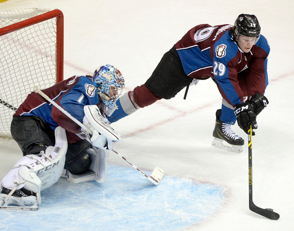 . Colorado center Nathan MacKinnon helped goalie Semyon Varlamov clear the puck in the second period. The Colorado Avalanche hosted the Boston Bruins at the Pepsi Center Friday night, March 21, 2014. (Photo by Karl Gehring/The Denver Post)
