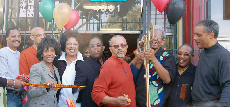 And the Ribbon is cut!  From Left:  Author Firpo Carr, Earl Ofari Hutchison, Congresswoman Maxine Waters, Congresswoman Diane Watson, Assemblyman Mark Ridley-Thomas, Tom Hamilton and James Fugate, r. Kwaku Person-lynn and Councilman Bernard Parks.