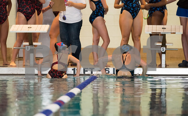 10/24/17 Wesley Bunnell | Staff Berlin girls swimming vs Southington on Tuesday evening at Plainville High School. Berlin and Southington swimmers prepare to exit the pool.