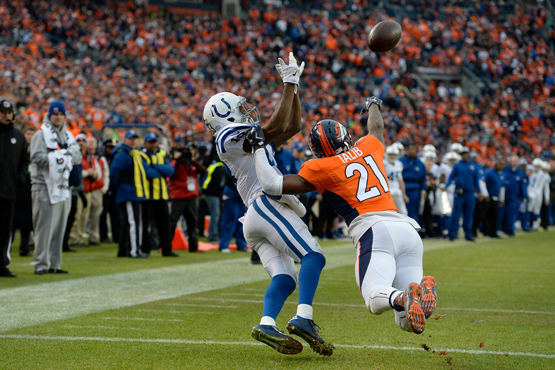 . Aqib Talib (21) of the Denver Broncos is called for a penalty while defending a pass to T.Y. Hilton (13) of the Indianapolis Colts in the second quarter. The Denver Broncos played the Indianapolis Colts in an AFC divisional playoff game at Sports Authority Field at Mile High in Denver on January 11, 2015. (Photo by John Leyba/The Denver Post)