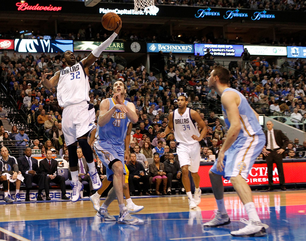 . Dallas Mavericks guard O.J. Mayo (L) shoots against Denver Nuggets center Kosta Koufos (2nd L), as Mavericks center Brandan Wright and Nuggets forward Danilo Gallinari (R) watch, during the first half of their NBA basketball game in Dallas, Texas, December 28, 2012.  REUTERS/Mike Stone