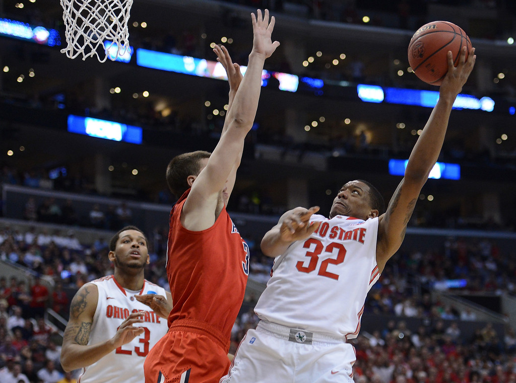 . Lenzelle Smith, Jr. #32 of the Ohio State Buckeyes goes up for a shot against Kaleb Tarczewski #35 of the Arizona Wildcats in the second half during the West Regional of the 2013 NCAA Men\'s Basketball Tournament at Staples Center on March 28, 2013 in Los Angeles, California.  (Photo by Harry How/Getty Images)
