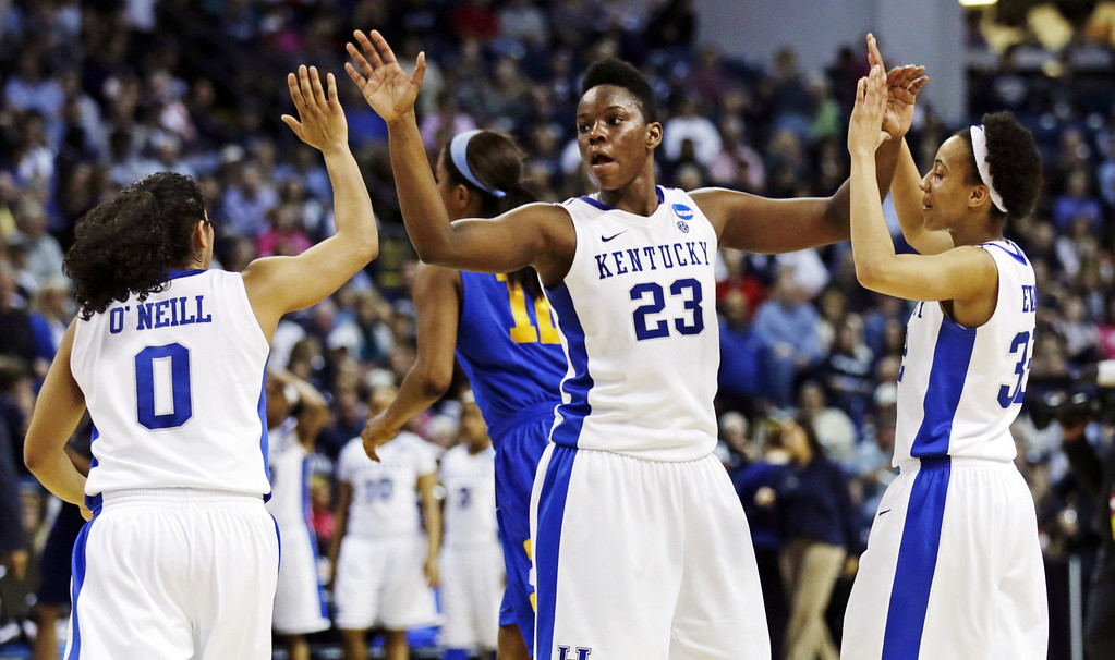 . Kentucky forward Samarie Walker (23) congratulates guards Jennifer O\'Neill (0) and Kastine Evans, right, after defeating Delaware 69-62 in a regional semifinal in the NCAA college basketball tournament in Bridgeport, Conn., Saturday, March 30, 2013. (AP Photo/Charles Krupa)