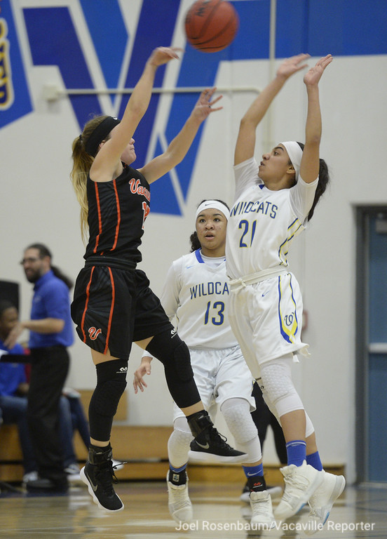 . Will C. Wood\'s Savannah Lopez pressures Kennedy Lydon as she makes a pass to a teammate during the first quarter.