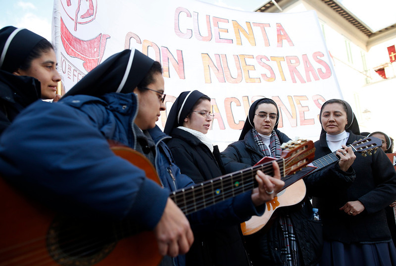 """. Nuns play guitars in front of the summer residence of Pope Benedict XVI in Castelgandolfo, February 28, 2013. Pope Benedict slips quietly from the world stage on Thursday after a private last goodbye to his cardinals and a short flight to a country palace to enter the final phase of his life \""""hidden from the world\"""".  REUTERS/Tony Gentile"""