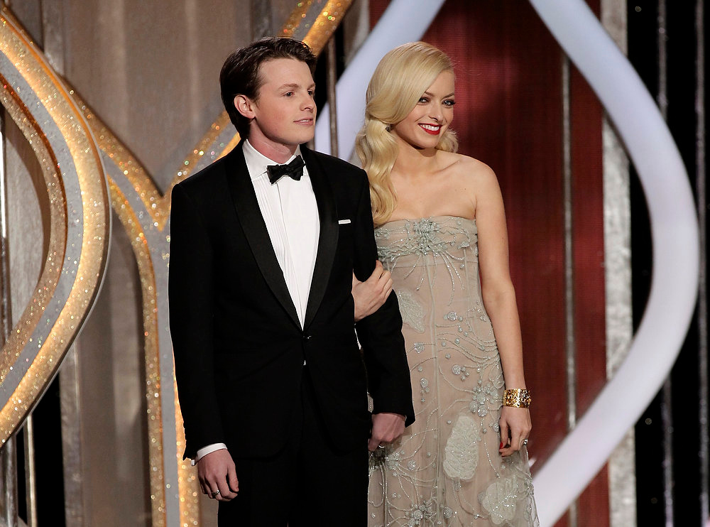 . This image released by NBC shows Sam Fox, Mister Golden Globe 2013, left, and Francesca Eastwood, Miss Golden Globe 2013, on stage during the 70th Annual Golden Globe Awards held at the Beverly Hilton Hotel on Sunday, Jan. 13, 2013, in Beverly Hills, Calif. (AP Photo/NBC, Paul Drinkwater)