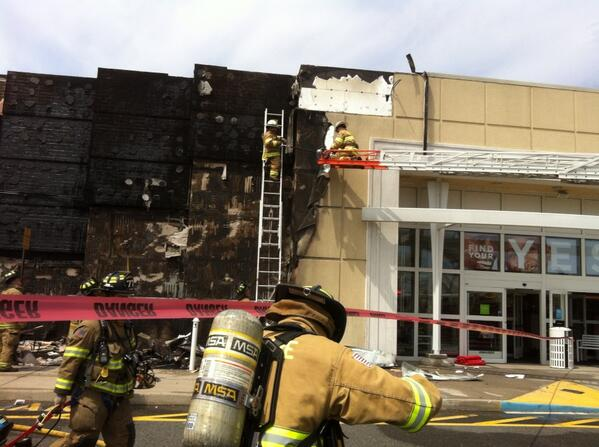 . Firefighters take the facade off the front of the Kohl\'s Department Store in Limerick, Pa., after a fire damaged it Friday, April 25, 2014. (Photo by Evan Brandt/The Mercury)