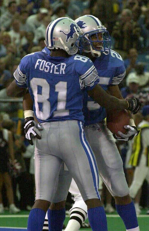 . Larry Foster (81) of the Detroit Lions congratulates teammate Lamont Warren (25) after he scored a touchdown before the half against the Cincinnati Bengals during Sunday\'s game played at the Pontiac Silverdome. The Lions lost 31-27 to the Bengals.