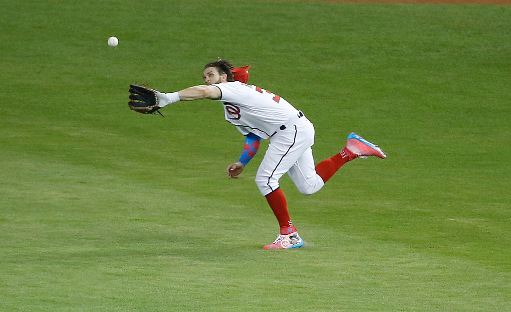. National League\'s Washington Nationals outfielder Bryce Harper (34) catches a hit by American League\'s Kansas City Royals Salvador Perez (13), during the second inning at the MLB baseball All-Star Game, Tuesday, July 11, 2017, in Miami. (AP Photo/Wilfredo Lee)