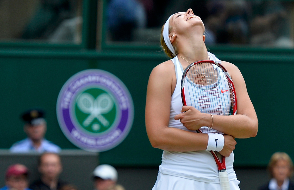 . Sabine Lisicki of Germany reacts during her women\'s singles tennis match against  Serena Williams of the U.S. at the Wimbledon Tennis Championships, in London July 1, 2013.      REUTERS/Toby Melville
