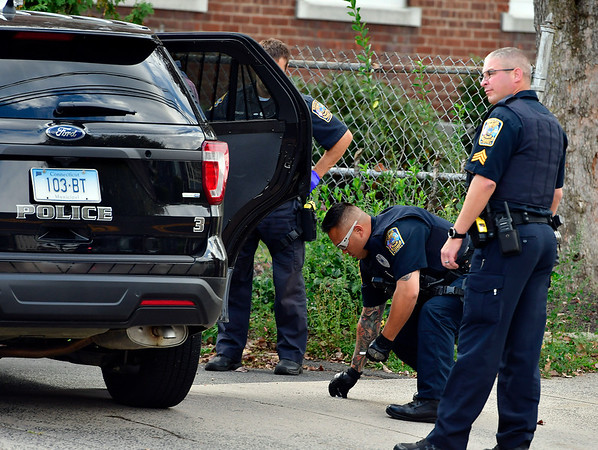 10/2//2019 Mike Orazzi | StaffrA man is taken into custody after a foot chase by members of the Bristol Police and Fire Departments on North Main Street after a report of a double carjacking on Wednesday afternoon.