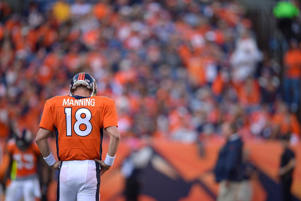 . Broncos quarterback Peyton Manning (18) pauses during the third quarter as the Broncos took on the Jacksonville Jaguars on October 13, 2013. (Photo by Joe Amon/The Denver Post)