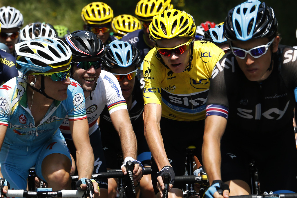 . Britain\'s Mark Cavendish (2ndL), Britain\'s Peter Kennaugh (C), Overall leader\'s yellow jersey Britain\'s Christopher Froome (2ndR), and Britain\'s Geraint Thomas (R) ride in the pack during the 191 km fourteenth stage of the 100th edition of the Tour de France cycling race on July 13, 2013 between Saint-Pourcain-sur-Sioule and Lyon, central eastern France. PASCAL GUYOT/AFP/Getty Images