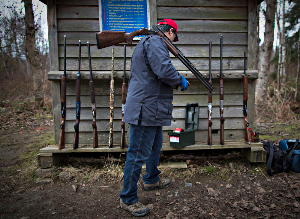 Description of . A member of the Vancouver Gun Club gets more ammunition while taking part in sporting clays at their facility in Richmond, British Columbia February 17, 2013. Sporting clays, also known as