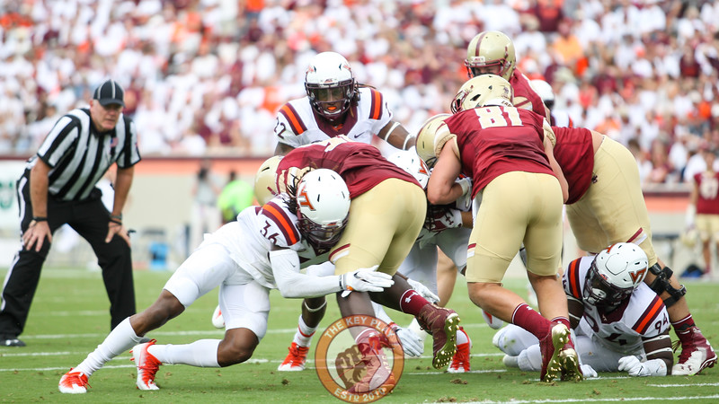 Adonis Alexander (36) tackles Boston College RB Jon Hilliman. (Mark Umansky/TheKeyPlay.com)